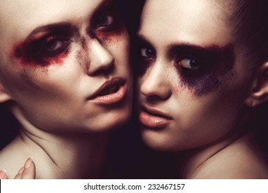 Portrait of two sexy girls with bright makeup close