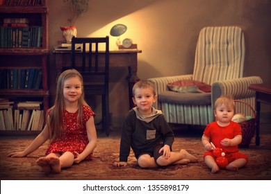 Portrait of two sisters and a brother. Image with selective focus and toning
