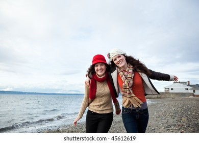 A portrait of two sisters on the beach