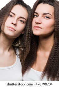 Portrait of two sisters twins. Close-up face