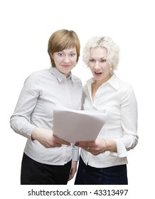 Portrait of two smiling businesswomans reading document  over white
