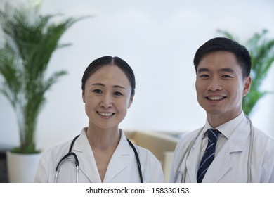 Portrait of two smiling doctors in hospital