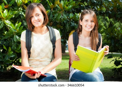 Portrait of two students in a park