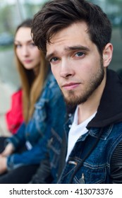 Portrait of two students talking in the street after class.