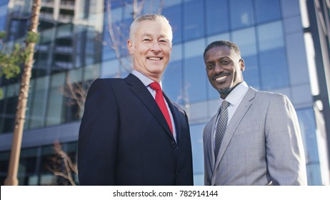 Portrait of two successful and confident business leaders in suits