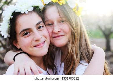 Portrait of two teenage girlfriends  outdoors