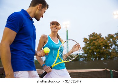 Portrait of a two tennis player talking outdoors