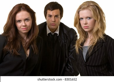 Portrait of two women lawyers with a male judge in between them all looking forward