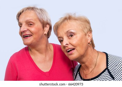 Portrait of two women on a white background, horizontal shot.