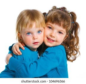 Portrait of two young beautiful sisters. Isolated over white background.