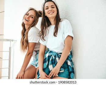 Portrait of two young beautiful smiling hipster female in trendy summer white t-shirt clothes.Sexy carefree women posing in street near white wall. Positive models having fun, hugging and going crazy - Shutterstock ID 1908582013
