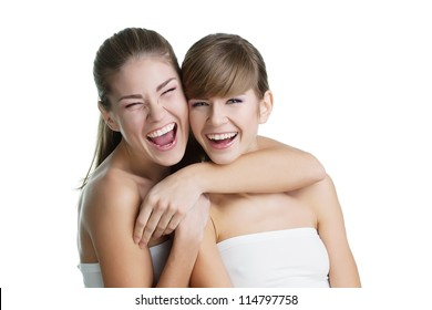 Portrait of two young beautiful women on white background smilin