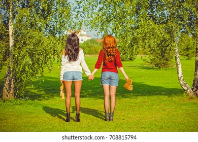 Portrait two young beautiful women enjoy life on a nature. Women's friendship as it is. Sisters rest in the park. The concept of friendship and relations among lesbians