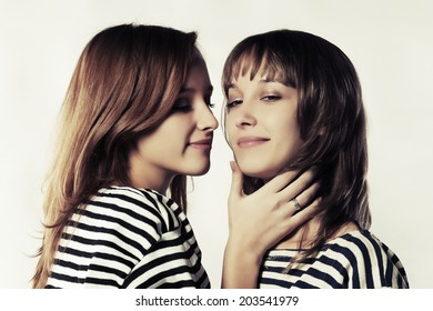 young girls kissing older women