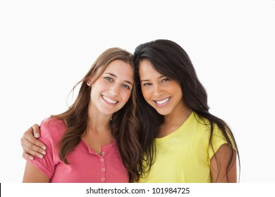 Portrait of two young friends against white background
