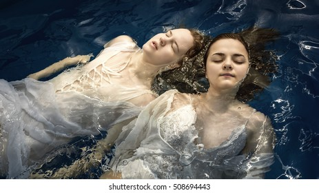 Portrait of two young girls in water
