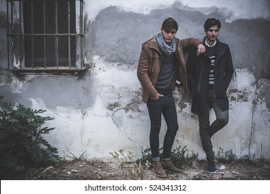 Portrait of two young man posing with fashionable winter clothes outdoors