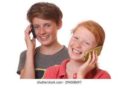 Portrait of two young teenagers talking with cell phones