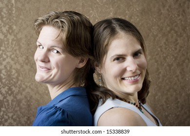 Portrait of Two Young Women Friends Back to Back