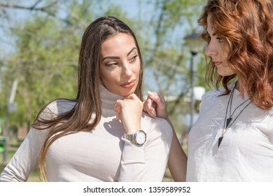 Portrait of two young women, Friendship never ends. Two attractive beautiful young woman. Candid outdoor shot Girls having fun