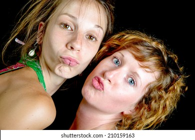 portrait of two young women on a black background