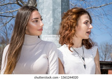 Portrait of two young women talkung, Friendship never ends. Two attractive beautiful young woman. Candid outdoor shot Girls having fun