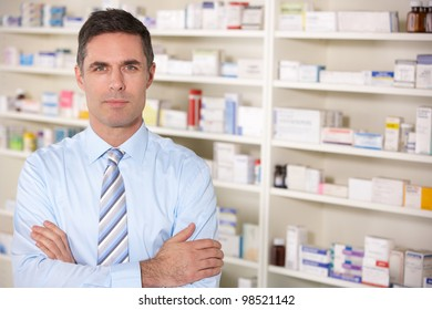 Portrait UK pharmacist at work