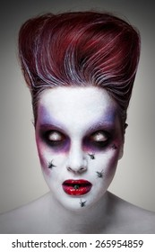 Portrait of an undead girl with red hair, white murky eyes, red lips and spiders crawling on her face