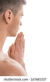 Portrait of undressed fit man praying. Back side view isolated over white background