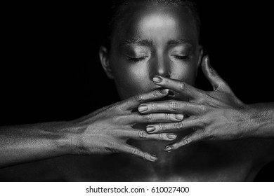 Portrait unearthly brilliant girls, hands near the face. Very delicate and feminine. The eyes are closed. Frame of hands.Black and white