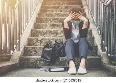 Portrait of unemployed businesswoman stressed after failure and laid off from work because impact from covid-19 pandemic outbreak. Conceptual of unemployed woman having negative feelings.