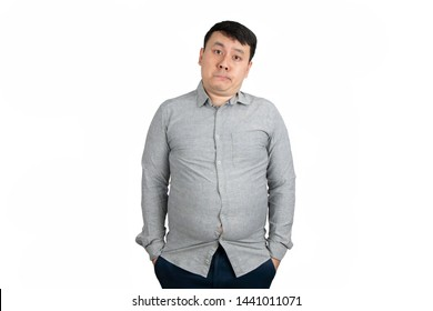 Portrait of unhappy Asian fat man with a big belly isolated on white background with copy space. Body shape, healthy and nutrition concept.