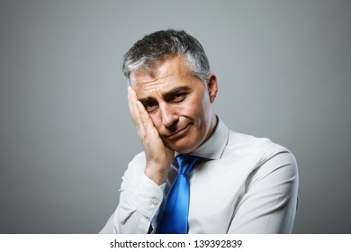 Portrait of an unhappy middle-aged businessman