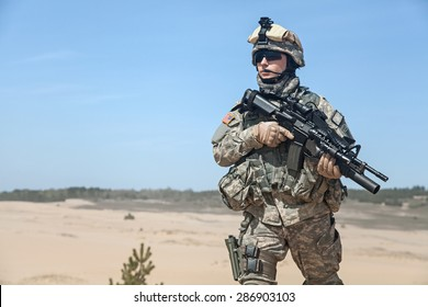 Portrait of United states airborne infantry corporal with arms, camo uniforms dress. Combat helmet on, half lengh portrait