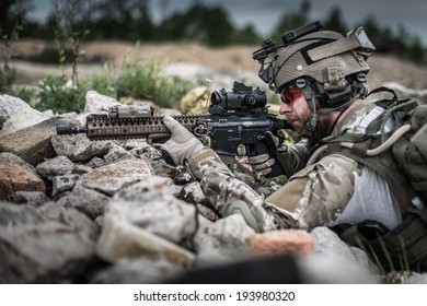 portrait of united states ranger hidden in ruins on battle field