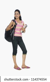 Portrait of a university student carrying a bag and books