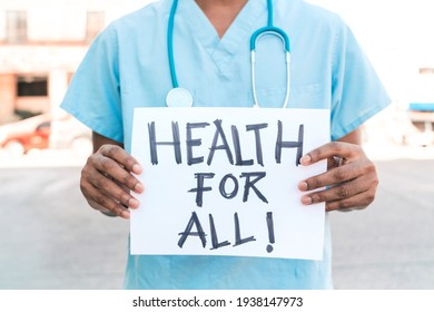 """portrait of an unrecognizable African American man holding a banner that says """"health for all"""" health crisis concept."""