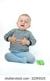 portrait of upset baby boy, on white
