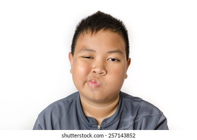 Portrait of upset boy  on white background
