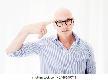 portrait of upset businessman with big head pointing his finger to head