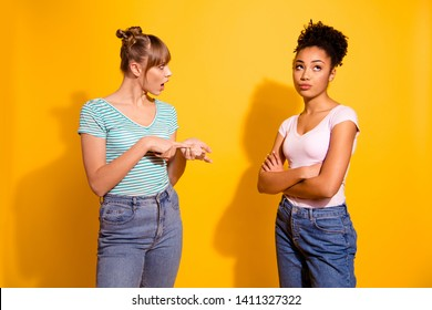 Portrait upset disappointed lady youth hairdo wavy curly discuss mad grimace misunderstanding disagreement shadow no communication trendy style stylish t-shirt top-knot isolated yellow background