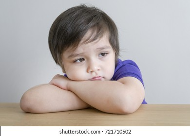Portrait of upset little boy, Kid sad face, Unhappy child looking out, Spoiled children concept
