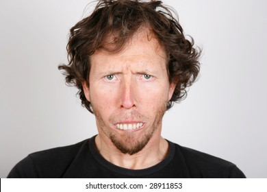 Portrait of an upset man with protruding teeth