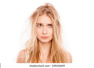 Portrait of upset young blonde woman woman with damaged hair