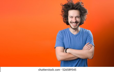 portrait of urban bearded man with funny hair against color background with copy space