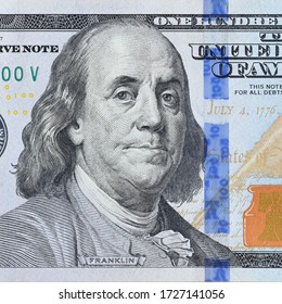 Portrait of US president Benjamin Franklin on 100 dollars banknote closeup macro fragment. United states hundred dollars money bill