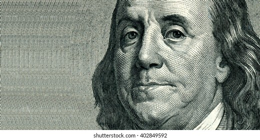 Portrait of U.S. statesman, inventor, and diplomat Benjamin Franklin as he looks on one hundred dollar bill obverse. The portrait is expanded from the right side