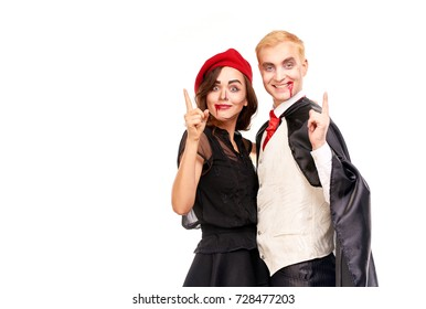 Portrait of vampire couple posing for Halloween against white background