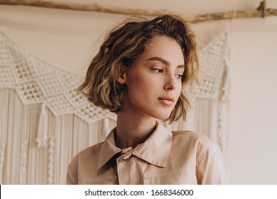 portrait of a very attractive blonde dressed in modern stylish clothes and with a mysterious and cute look in the camera