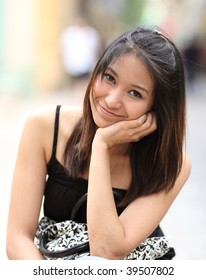 Portrait of a very attractive young asian woman with a lovely smile looking at the camera
